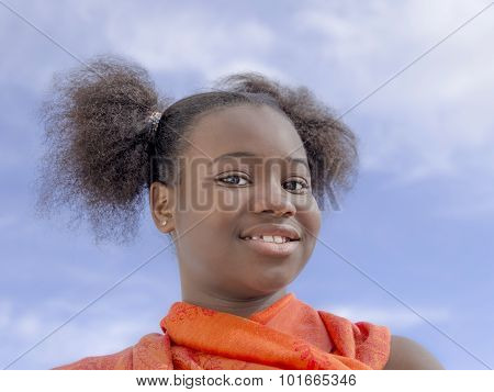 Afro girl with pigtails smiling, ten years old