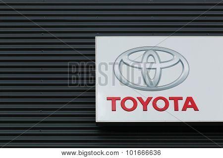 Toyota logo on a facade of a dealer