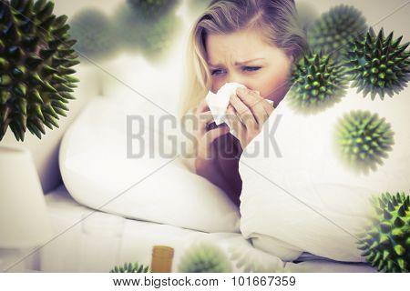 Blonde woman sneezing against virus