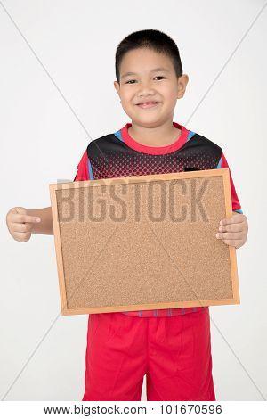 Little Asian Boy Holding Empty Wood Board In Sport Unifrom