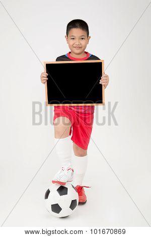 Little Asian Boy Holding Empty Wood Blackboard In Sports Unifrom