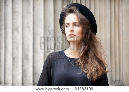 stylish young woman looking away