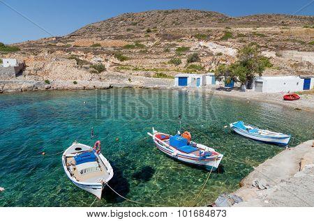 Traditional fishing boats in Ag. Nikolas bay, Kimolos island, Cyclades, Greece