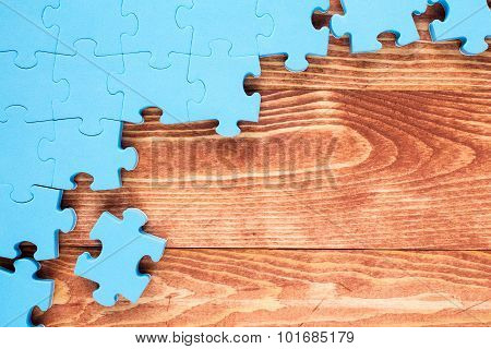 Puzzle On Brown Wooden Background