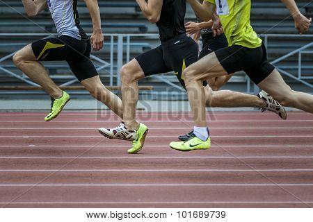 sprinters run the 100 meters in the stadium