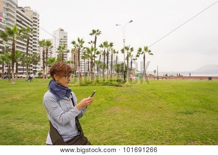 Checking Smart Phone In Lima Miraflores