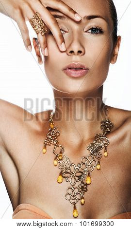 Portrait of a beautiful woman. Jewelry make-up.