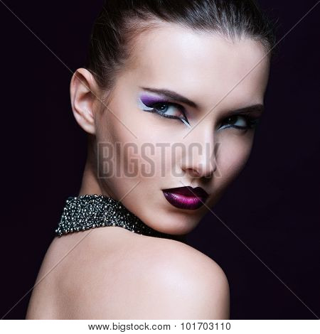Beauty Woman With Perfect Makeup. Beautiful Professional Holiday Make-up. Purple Lips And Nails. Bea