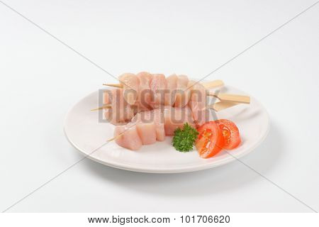 plate of raw chicken skewers