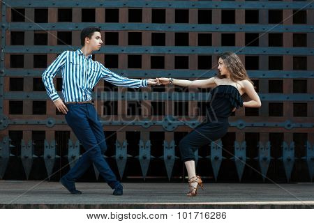 Guy With A Girl Dancing In The Street Dancing.