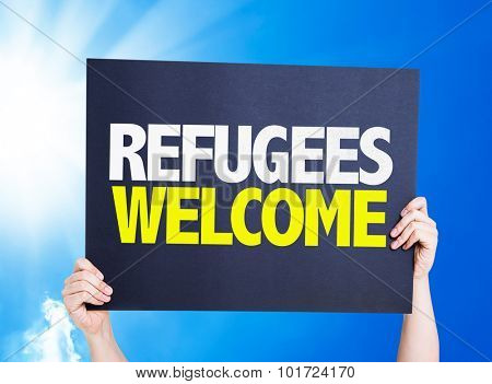 Refugees Welcome placard with sky background