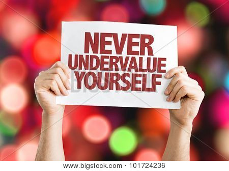 Never Undervalue Yourself placard with bokeh background