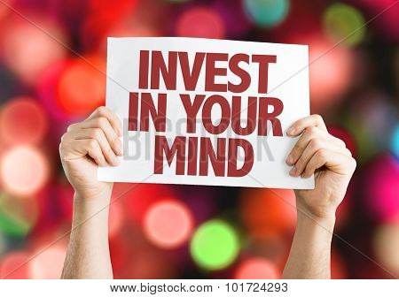 Invest In Your Mind placard with bokeh background