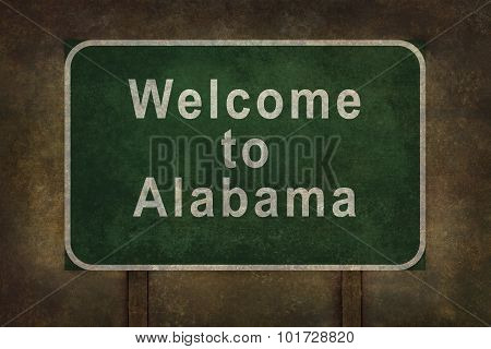 Welcome to Alabama roadside sign with Ominous Background