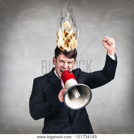 man having his brain on fire because of stress