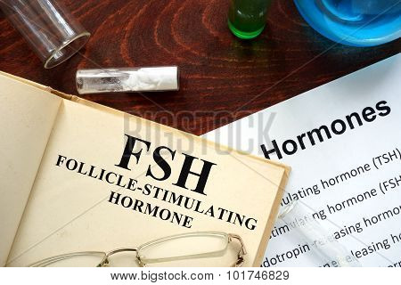 follicle-stimulating hormone FSH written on book.