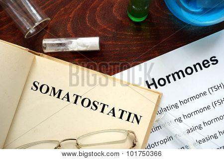 Hormone somatostatin written on book.