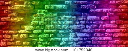 Concept or conceptual colorful painted old vintage grungy brick wall texture or urban background banner
