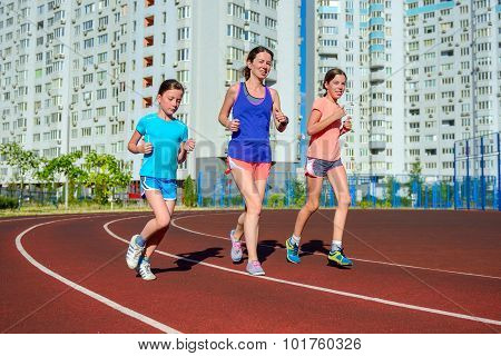 Family sport, happy active mother and kids jogging on track, running and working out on stadium in modern city poster