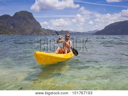 Young people rowing in kayak