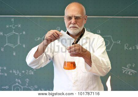 Professor Mixes Chemicals