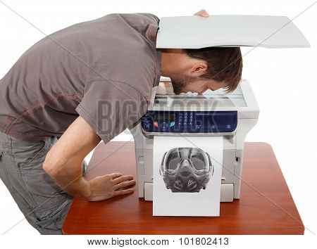 Man Scanning His Face In Copier