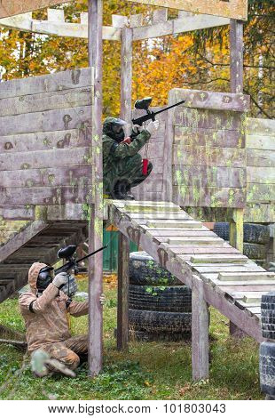 Two Paintball Shooters Defending The Fortification outdoors poster
