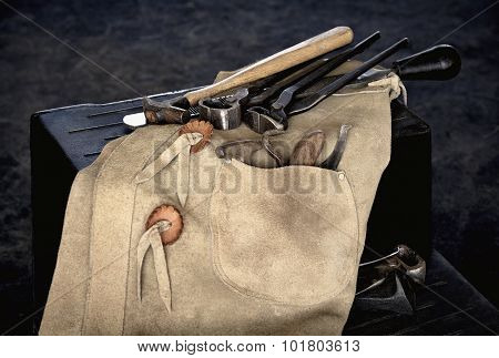 Farrier Tools With Chaps On Stool