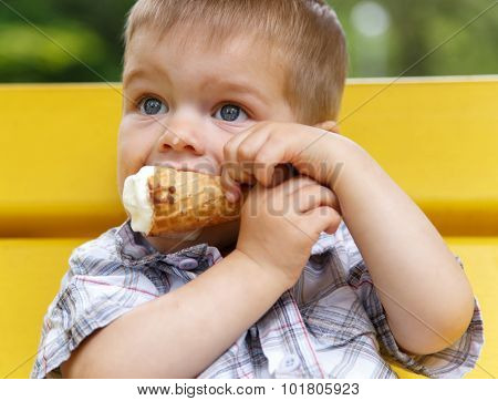 Portrait Of Funny Kid Biting Ice-cream  Cone