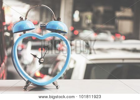 retro blue clock over traffic jam