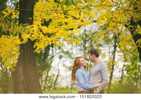 Happy Couple Hagging In Autumn Forest