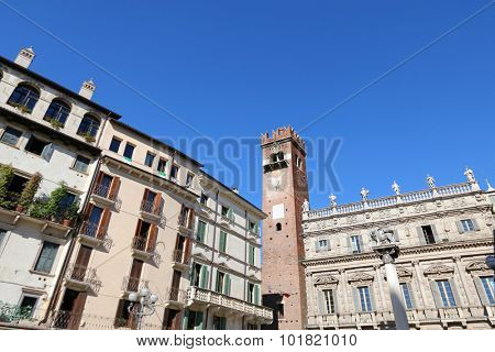 VERONA, ITALY - SEPTEMBER 2014 : Torre del Gardello - XII century (Gardello Tower) and the facade of Palazzo Maffei, a historical palace on Piazza delle Erbe in Verona, Italy on September 14, 2014.