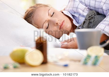 Young Female Caught Cold Laying In Bed Sleeping