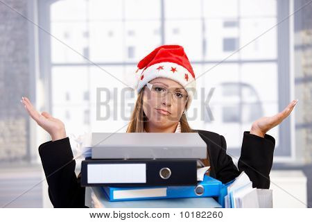 Young Woman In Santa Hat Having Too Much Work