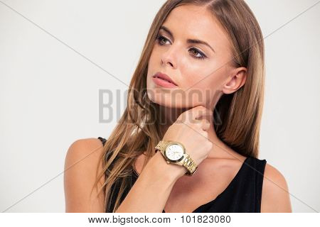 Portrait of a fashion woman standing isoalted on a white background
