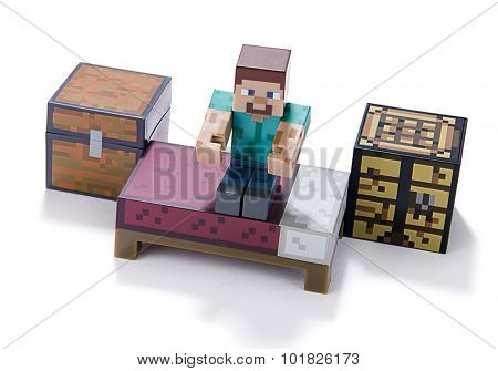 Ankara, Turkey  July 01, 2015: Minecraft figure Herobrine stands on bed isolated on white background.  Minecraft is a game about breaking and placing blocks.