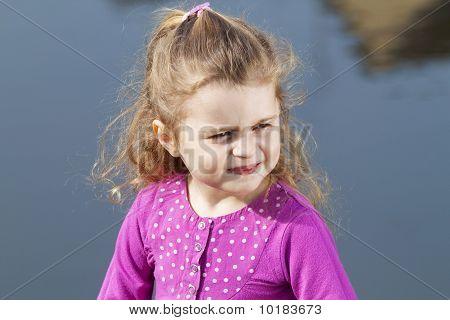 Little girl ashore river.