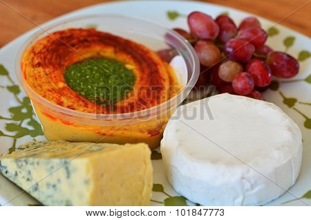 Mezze Plate with cheese hummus and grapes.