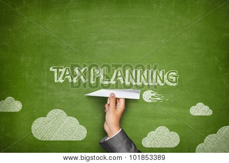 Tax planning concept on blackboard with paper plane