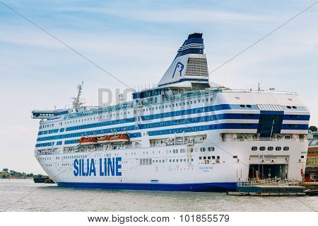 Modern ferry boat - Silja Line - at pier awaiting loading cargo