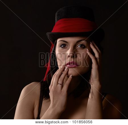 Woman In Black Tophat With Red Shawl