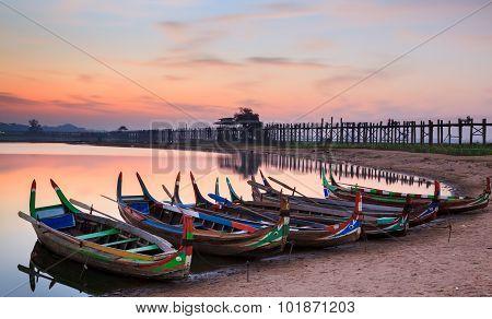Wooden Boat In Ubein Bridge At Sunrise, Mandalay, Myanmar