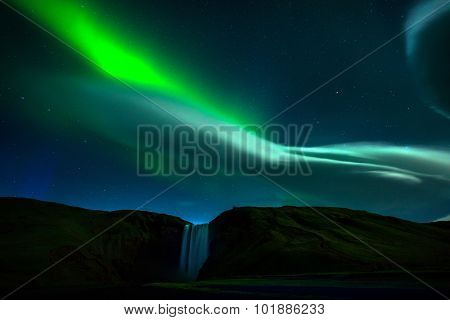 aurora over waterfalls