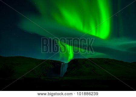 aurora over waterfalls