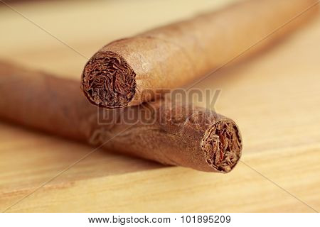 Cigars On Wooden Board