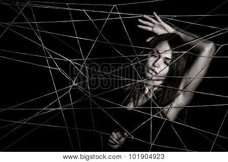 Young Woman Entangled The Net Of Ropes