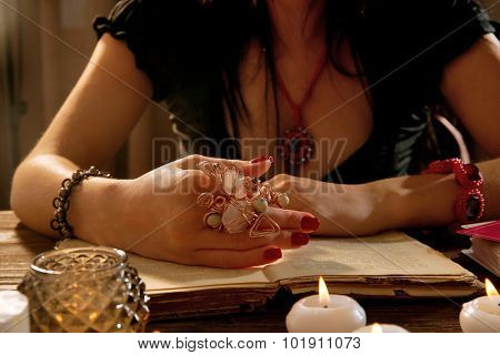 Witch - fortune teller reading fortune close up