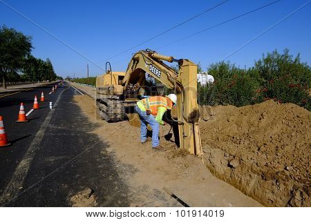 Foreman Inspects Trench