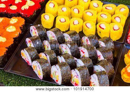 Sushi Rolls On Thailand Street Food Vender.