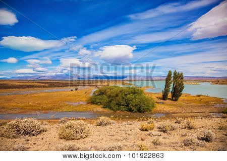 Argentine Patagonia in February. Yellow flat scorched desert with shallow lakes